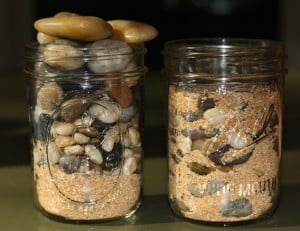 Jars of mixed rocks and sand