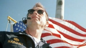 David Marquet in front of US flag
